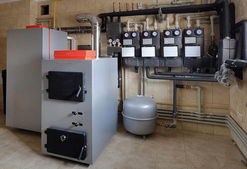 Монтаж твердотопливного отопления в частном доме в Москве